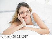 Купить «Pretty brunette woman lying on her bed smiling at camera», фото № 30021627, снято 3 июля 2013 г. (c) Wavebreak Media / Фотобанк Лори