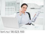 Купить «Businesswoman with graphs and laptop gesturing okay sign in office», фото № 30023183, снято 16 июля 2013 г. (c) Wavebreak Media / Фотобанк Лори