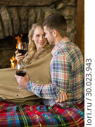 Купить «Romantic couple with wineglasses in front of lit fireplace», фото № 30023943, снято 21 августа 2013 г. (c) Wavebreak Media / Фотобанк Лори