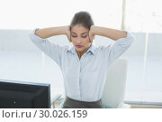 Купить «Businesswoman suffering from headache at office», фото № 30026159, снято 30 июля 2013 г. (c) Wavebreak Media / Фотобанк Лори