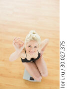 Купить «Cheerful woman gesturing ok sign on scale in fitness studio», фото № 30027375, снято 6 августа 2013 г. (c) Wavebreak Media / Фотобанк Лори