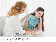 Купить «Young woman consoling female friend at home», фото № 30028343, снято 16 августа 2013 г. (c) Wavebreak Media / Фотобанк Лори