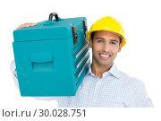 Купить «Portrait of a handyman in hard hat carrying a toolbox», фото № 30028751, снято 8 августа 2013 г. (c) Wavebreak Media / Фотобанк Лори