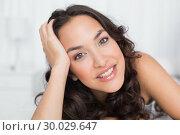 Купить «Closeup portrait of a pretty brunette in bed», фото № 30029647, снято 15 августа 2013 г. (c) Wavebreak Media / Фотобанк Лори