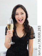 Купить «Portrait of a beautiful young woman with champagne», фото № 30030283, снято 29 августа 2013 г. (c) Wavebreak Media / Фотобанк Лори