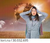Купить «Composite image of anxious pretty brunette wearing winter clothes posing», фото № 30032695, снято 2 ноября 2013 г. (c) Wavebreak Media / Фотобанк Лори