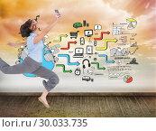 Купить «Composite image of happy classy businesswoman jumping while holding smartphone», фото № 30033735, снято 2 ноября 2013 г. (c) Wavebreak Media / Фотобанк Лори