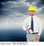 Купить «Composite image of cheerful young architect posing», фото № 30034627, снято 2 ноября 2013 г. (c) Wavebreak Media / Фотобанк Лори