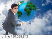 Купить «Composite image of unsmiling businessman catching», фото № 30038843, снято 10 ноября 2013 г. (c) Wavebreak Media / Фотобанк Лори