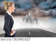 Купить «Composite image of businesswoman standing with hands on hips», фото № 30043627, снято 11 ноября 2013 г. (c) Wavebreak Media / Фотобанк Лори