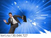 Купить «Composite image of smiling businessman in a hury», фото № 30044727, снято 11 ноября 2013 г. (c) Wavebreak Media / Фотобанк Лори