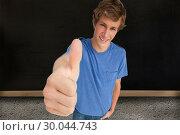 Купить «Composite image of fisheye view of a male student the thumbup», фото № 30044743, снято 11 ноября 2013 г. (c) Wavebreak Media / Фотобанк Лори