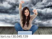 Купить «Composite image of woman looks straight ahead as she celebrates in front of her laptop», фото № 30045139, снято 11 ноября 2013 г. (c) Wavebreak Media / Фотобанк Лори