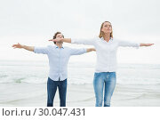 Купить «Casual couple with eyes closed at beach», фото № 30047431, снято 10 октября 2013 г. (c) Wavebreak Media / Фотобанк Лори