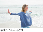 Купить «Woman standing with arms outstretched at beach», фото № 30047491, снято 10 октября 2013 г. (c) Wavebreak Media / Фотобанк Лори
