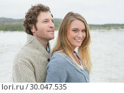 Купить «Relaxed romantic young couple at beach», фото № 30047535, снято 10 октября 2013 г. (c) Wavebreak Media / Фотобанк Лори