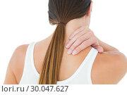 Купить «Rear view of a casual woman suffering from neck ache», фото № 30047627, снято 15 октября 2013 г. (c) Wavebreak Media / Фотобанк Лори