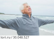 Купить «Senior man with arms outstretched at beach», фото № 30048527, снято 11 октября 2013 г. (c) Wavebreak Media / Фотобанк Лори