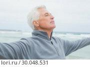 Купить «Senior man with arms outstretched at beach», фото № 30048531, снято 11 октября 2013 г. (c) Wavebreak Media / Фотобанк Лори