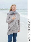 Купить «Smiling casual senior woman at beach», фото № 30048547, снято 11 октября 2013 г. (c) Wavebreak Media / Фотобанк Лори