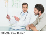 Купить «Male doctor explaining spine xray to patient», фото № 30048827, снято 16 октября 2013 г. (c) Wavebreak Media / Фотобанк Лори