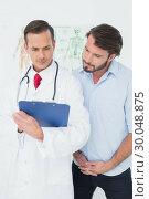 Купить «Male doctor discussing reports with patient», фото № 30048875, снято 16 октября 2013 г. (c) Wavebreak Media / Фотобанк Лори