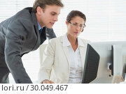 Купить «Smartly dressed business couple using computer», фото № 30049467, снято 3 ноября 2013 г. (c) Wavebreak Media / Фотобанк Лори