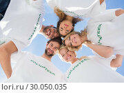 Купить «Happy volunteers forming a huddle against blue sky», фото № 30050035, снято 4 ноября 2013 г. (c) Wavebreak Media / Фотобанк Лори