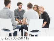 Купить «Group therapy in session sitting in a circle», фото № 30050115, снято 4 ноября 2013 г. (c) Wavebreak Media / Фотобанк Лори