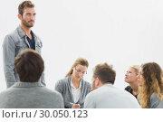 Купить «Group therapy in session sitting in a circle», фото № 30050123, снято 4 ноября 2013 г. (c) Wavebreak Media / Фотобанк Лори
