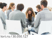 Купить «Group therapy in session sitting in a circle», фото № 30050127, снято 4 ноября 2013 г. (c) Wavebreak Media / Фотобанк Лори