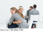Купить «Group therapy session with therapist and client hugging», фото № 30050143, снято 4 ноября 2013 г. (c) Wavebreak Media / Фотобанк Лори