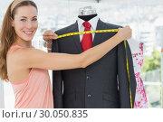 Купить «Female fashion designer measuring suit on dummy», фото № 30050835, снято 5 ноября 2013 г. (c) Wavebreak Media / Фотобанк Лори