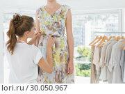 Купить «Fashion designer adjusting dress on model», фото № 30050967, снято 5 ноября 2013 г. (c) Wavebreak Media / Фотобанк Лори