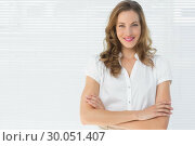 Купить «Smiling businesswoman with arms crossed against blinds», фото № 30051407, снято 2 ноября 2013 г. (c) Wavebreak Media / Фотобанк Лори