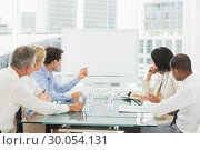 Купить «Business people looking at blank whiteboard in conference room», фото № 30054131, снято 3 ноября 2013 г. (c) Wavebreak Media / Фотобанк Лори