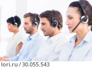 Купить «Group of business colleagues with headsets in a row», фото № 30055543, снято 2 ноября 2013 г. (c) Wavebreak Media / Фотобанк Лори
