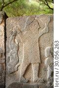 Купить «Pictures & images of the South Gate Hittite sculpture stele depicting Hittite Gods. 8th century BC. Karatepe Aslantas Open-Air Museum (Karatepe-AslantaŠŸ Açık Hava Müzesi), Osmaniye Province, Turkey.», фото № 30056263, снято 3 июля 2018 г. (c) age Fotostock / Фотобанк Лори