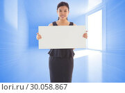 Купить «Composite image of businesswoman holding a placard», фото № 30058867, снято 11 декабря 2013 г. (c) Wavebreak Media / Фотобанк Лори