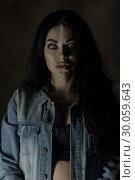 Scary woman with mad eyes in darkness. Стоковое фото, фотограф Art Konovalov / Фотобанк Лори