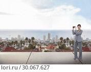 Купить «Composite image of businesswoman posing with binoculars», фото № 30067627, снято 15 января 2014 г. (c) Wavebreak Media / Фотобанк Лори