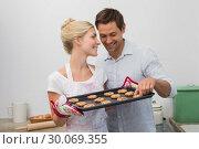 Купить «Couple preparing cookies together in kitchen», фото № 30069355, снято 5 декабря 2013 г. (c) Wavebreak Media / Фотобанк Лори