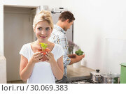 Купить «Couple with young potted plants in the kitchen», фото № 30069383, снято 5 декабря 2013 г. (c) Wavebreak Media / Фотобанк Лори