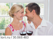 Купить «Loving couple with wine glasses looking at each other», фото № 30069483, снято 5 декабря 2013 г. (c) Wavebreak Media / Фотобанк Лори