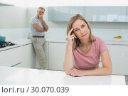 Купить «Unhappy couple not talking after an argument in kitchen», фото № 30070039, снято 18 октября 2013 г. (c) Wavebreak Media / Фотобанк Лори