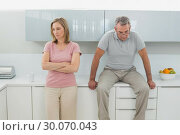 Купить «Couple not talking after an argument in kitchen», фото № 30070043, снято 18 октября 2013 г. (c) Wavebreak Media / Фотобанк Лори