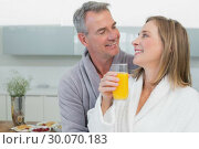 Купить «Loving couple looking at each other in kitchen», фото № 30070183, снято 18 октября 2013 г. (c) Wavebreak Media / Фотобанк Лори