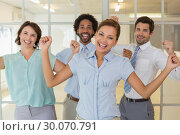 Купить «Cheerful business colleagues cheering in office», фото № 30070791, снято 19 декабря 2013 г. (c) Wavebreak Media / Фотобанк Лори