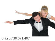 Купить «Playful newly wed couple with arms outstretched», фото № 30071407, снято 8 октября 2013 г. (c) Wavebreak Media / Фотобанк Лори