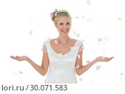 Купить «Bride being showered with petals over white background», фото № 30071583, снято 8 октября 2013 г. (c) Wavebreak Media / Фотобанк Лори